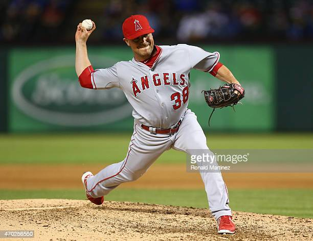 Joe Smith of the Los Angeles Angels throws against the Texas Rangers in the 8th inning at Globe Life Park in Arlington on April 13 2015 in Arlington...