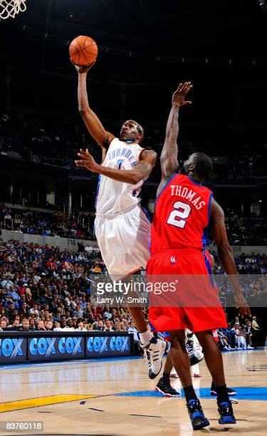 Joe Smith of the Oklahoma City Thunder goes to the basket against Tim Thomas of the Los Angeles Clippers at the Ford Center on November 19 2008 in...