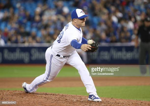 Joe Smith of the Toronto Blue Jays delivers a pitch in the eighth inning during MLB game action against the Baltimore Orioles at Rogers Centre on...