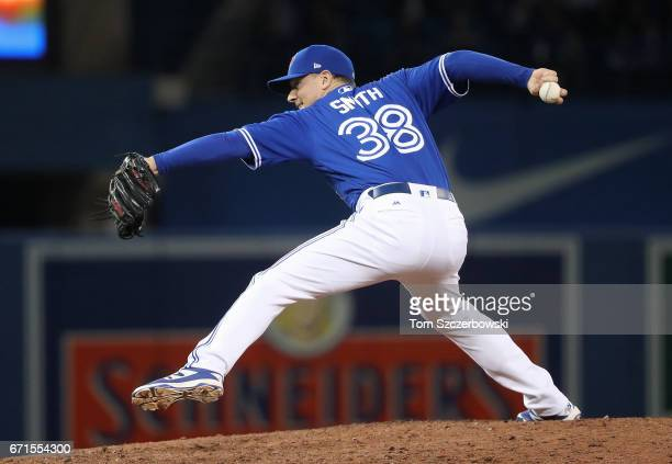 Joe Smith of the Toronto Blue Jays delivers a pitch in the eighth inning during MLB game action against the Boston Red Sox at Rogers Centre on April...