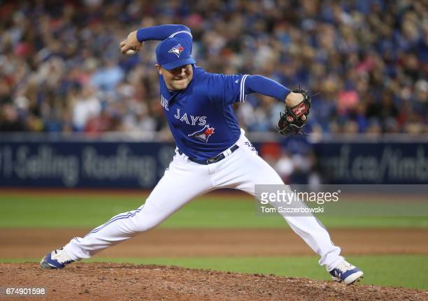 Joe Smith of the Toronto Blue Jays delivers a pitch in the eighth inning during MLB game action against the Tampa Bay Rays at Rogers Centre on April...