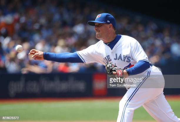 Joe Smith of the Toronto Blue Jays delivers a pitch in the seventh inning during MLB game action against the Oakland Athletics at Rogers Centre on...
