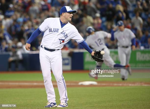 Joe Smith of the Toronto Blue Jays gets the ball back after giving up a threerun home run to Rougned Odor of the Texas Rangers in the ninth inning...