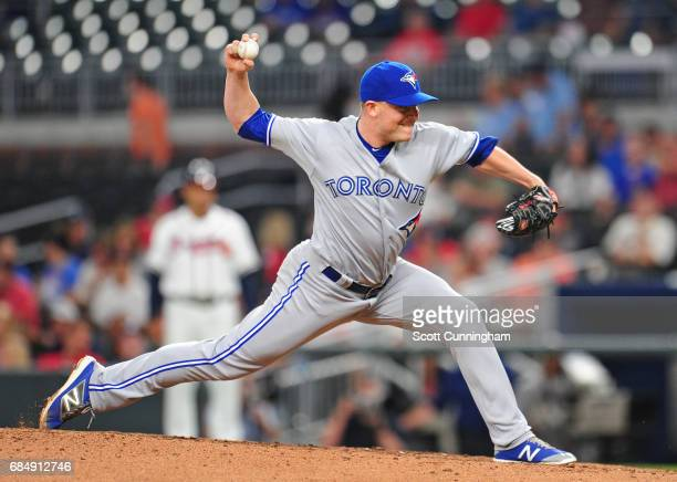 Joe Smith of the Toronto Blue Jays throws an eighth inning pitch against the Atlanta Braves at SunTrust Park on May 18 2017 in Atlanta Georgia
