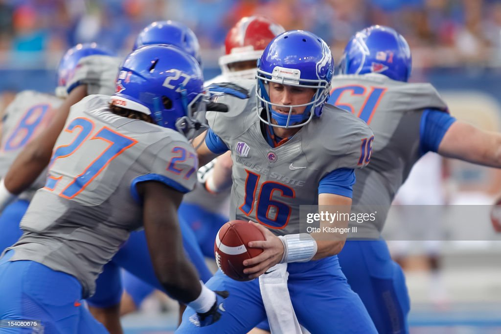 Joe Southwick of the Boise State Broncos hands off the ball to Jay Ajayi during the game against the Fresno State Bulldogs at Bronco Stadium on...