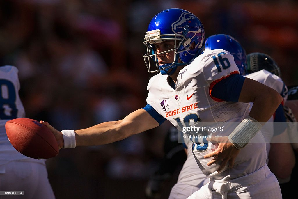 Joe Southwick of the Boise State Broncos hands the ball off during a NCAA college football game against the Hawaii Warriors on November 10 2012 at...