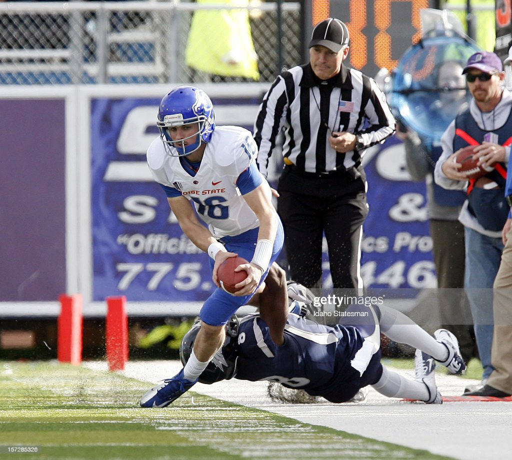 Joe Southwick of the Boise State Broncos heads up field against the University of Nevada at Mackay Stadium on Saturday December 1 in Reno Nevada The...