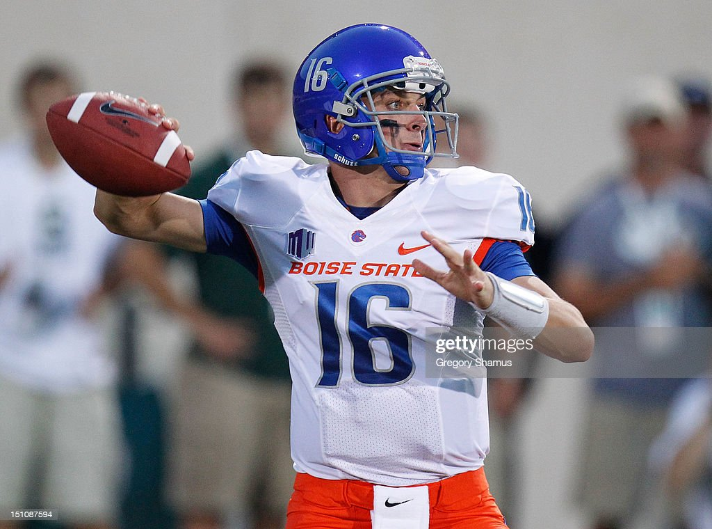 Joe Southwick of the Boise State Broncos throws a first quarter pass while playing the Michigan State Spartans at Spartan Stadium on August 2010 in...
