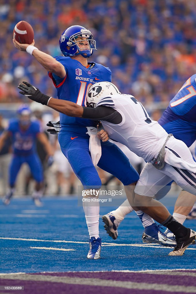 Joe Southwick of the Boise State Broncos throws just ahead of a hit by Preston Hadley of the BYU Cougars at Bronco Stadium on September 20 2012 in...