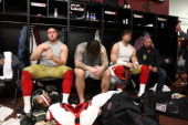 Joe Staley Adam Snyder and Alex Boone of the San Francisco 49ers sit at their lockers in the locker room following the game against the New York...