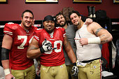 Joe Staley Isaac Sopoaga Adam Snyder and Alex Boone of the San Francisco 49ers celebrate in the locker room following the game against the New...