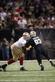 Joe Staley of the San Francisco 49ers blocks during the game against the New Orleans Saints at the Superdome on November 17 2013 in New Orleans...