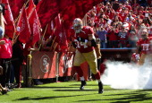 Joe Staley of the San Francisco 49ers runs onto the field during player introduction prior to playing the Arizona Cardinals at Candlestick Park on...