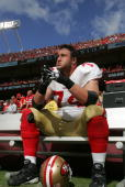 Joe Staley of the San Francisco 49ers sits on the bench during the game against the Kansas City Chiefs at Arrowhead Stadium on September 26 2010 in...