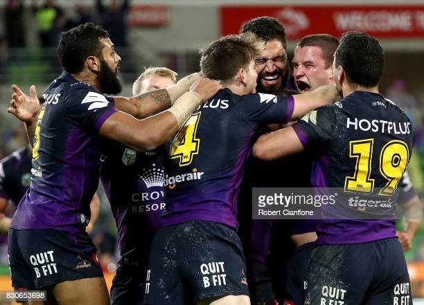 Joe Stimson of the Storm celebrates a try during the round 23 NRL match between the Melbourne Storm and the Sydney Roosters at AAMI Park on August 12...