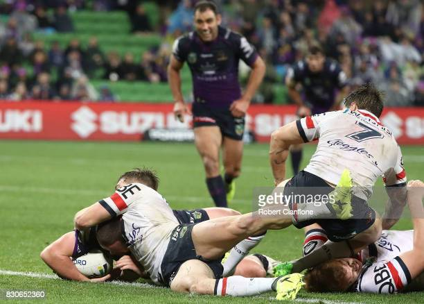 Joe Stimson of the Storm scores a try during the round 23 NRL match between the Melbourne Storm and the Sydney Roosters at AAMI Park on August 12...