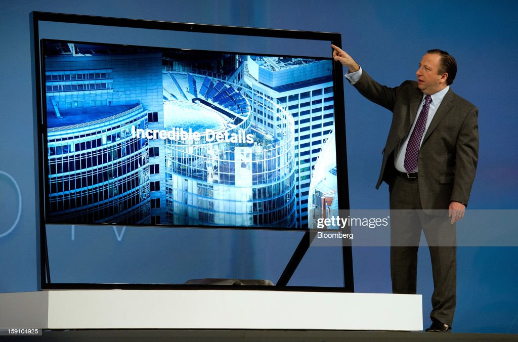 Joe Stinziano, executive vice president of Samsung Electronics America Inc., shows off the new Samsung's Ultra HDTV as he speaks during a news conference at the 2013 Consumer Electronic Show in Las Vegas, Nevada, U.S., on Monday, Jan. 7, 2013. The 2013 CES trade show, which runs until Jan. 11, is the world's largest annual innovation event that offers an array of entrepreneur focused exhibits, events and conference sessions for technology entrepreneurs. Photographer: David Paul Morris/Bloomberg via Getty Images