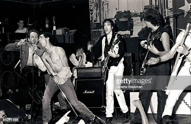 Joe Strummer Jimmy Pursey of Sham 69 Mick Jones and Steve Jones of Sex Pistols jam to 'White Riot' during a Clash gig at Music Machine 1978 in London