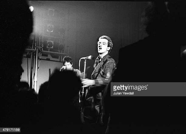 Joe Strummer performing with British punk group The Clash at the Coliseum Harlesden London 11th March 1977 On the left is guitarist Mick Jones