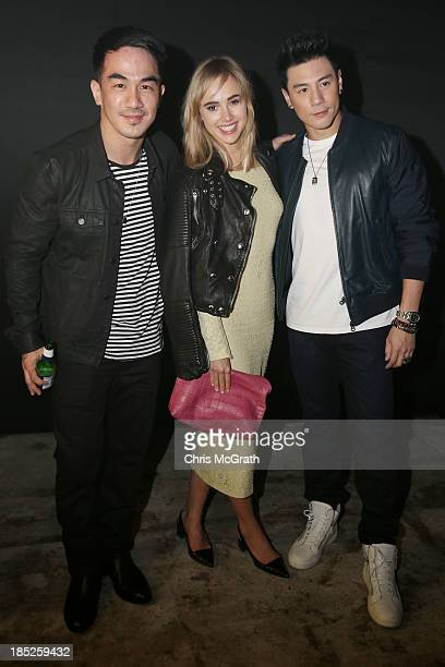 Joe Taslim Suki Waterhouse and Dome attend the Burberry Brit Rhythm gig wearing Burberry on October 18 2013 in Singapore