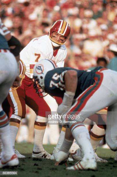 Joe Theismann of the Washington Redskins calls the count against the Miami Dolphins during Super Bowl XVII on January 30 1983 at the Rose Bowl in...
