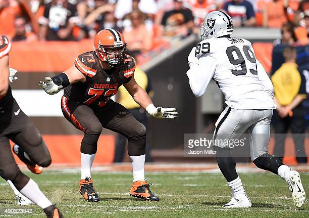 Joe Thomas of the Cleveland Browns blocks Aldon Smith of the Oakland Raiders during the third quarter at FirstEnergy Stadium on September 27 2015 in...