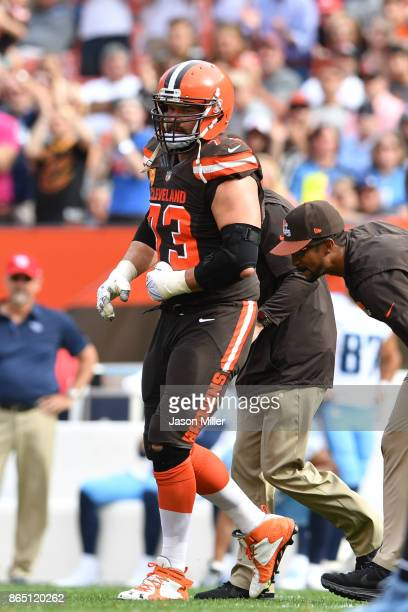 Joe Thomas of the Cleveland Browns leaves the field with an injury against the Tennessee Titans in the second half at FirstEnergy Stadium on October...