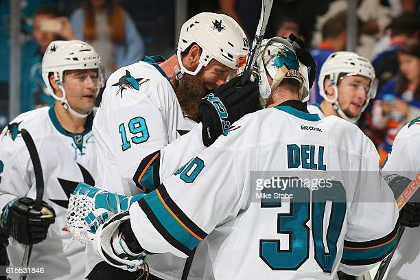 Joe Thornton and Aaron Dell of the San Jose Sharks celebrate after defeating the New York Islanders 32 at the Barclays Center on October 18 2016 in...