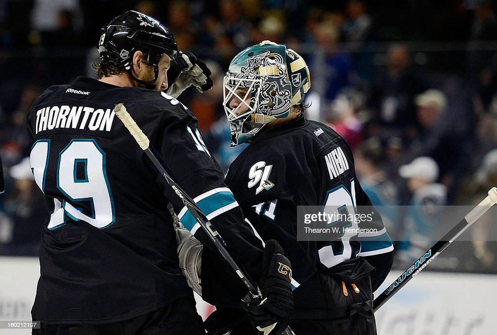 Joe Thornton #19 and Antti Niemi #31 of the San Jose Sharks celebrate defeating the Vancouver Canucks 4-1 at HP Pavilion on January 27, 2013 in San Jose, California.