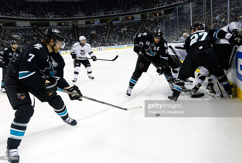 <a gi-track='captionPersonalityLinkClicked' href=/galleries/search?phrase=Joe+Thornton&family=editorial&specificpeople=201829 ng-click='$event.stopPropagation()'>Joe Thornton</a> #19 and <a gi-track='captionPersonalityLinkClicked' href=/galleries/search?phrase=Brad+Stuart+-+Ice+Hockey+Player&family=editorial&specificpeople=213995 ng-click='$event.stopPropagation()'>Brad Stuart</a> #7 of the San Jose Sharks skate for control of the puck against the Los Angeles Kings in the third period in Game Four of the Western Conference Semifinals during the 2013 NHL Stanley Cup Playoffs at HP Pavilion on May 21, 2013 in San Jose, California.