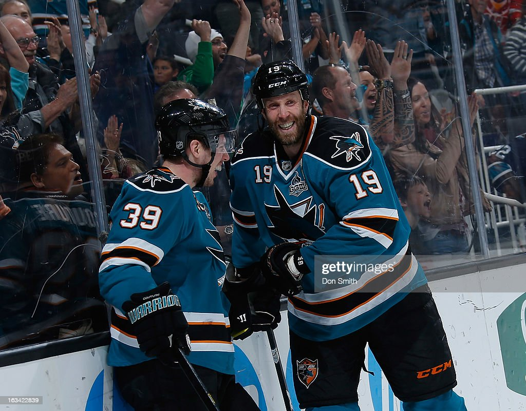 Joe Thornton #19 and Logan Couture #39 of the San Jose Sharks celebrate Couture's goal against the St. Louis Blues during an NHL game on March 9, 2013 at HP Pavilion in San Jose, California.