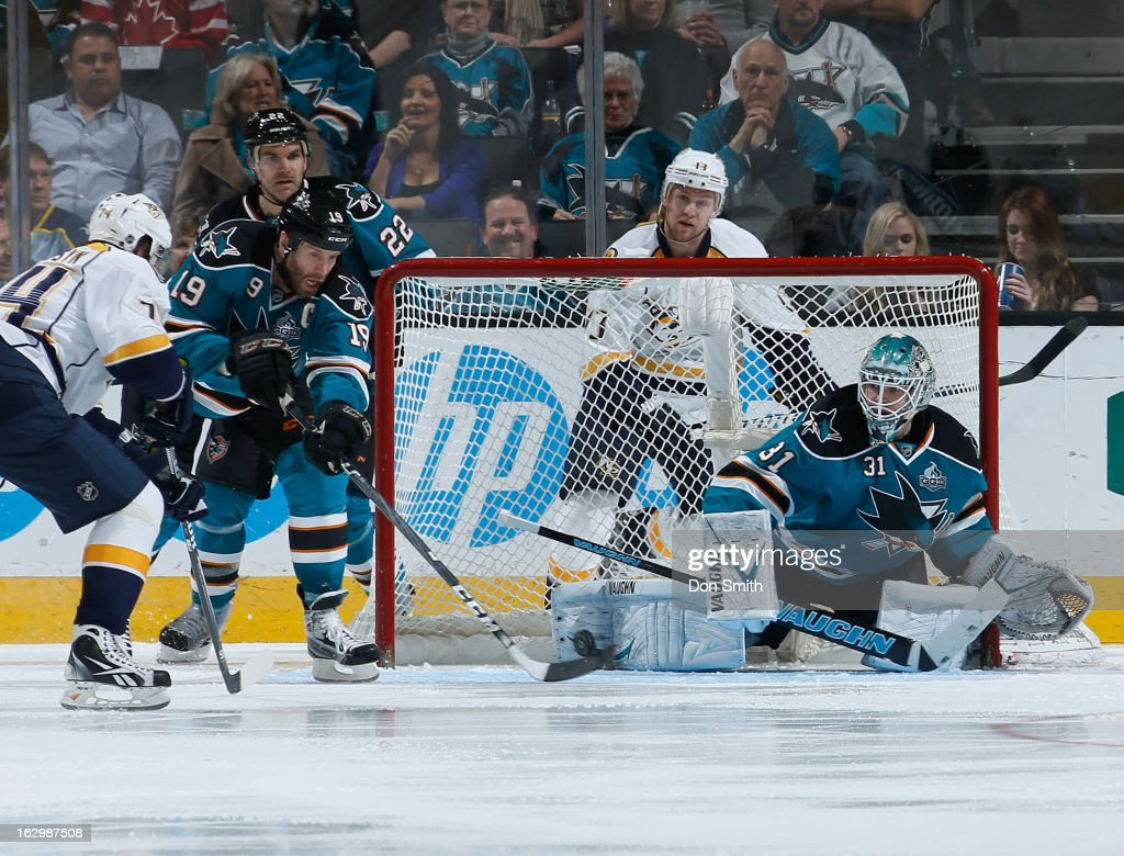 <a gi-track='captionPersonalityLinkClicked' href=/galleries/search?phrase=Joe+Thornton&family=editorial&specificpeople=201829 ng-click='$event.stopPropagation()'>Joe Thornton</a> #19, <a gi-track='captionPersonalityLinkClicked' href=/galleries/search?phrase=Antti+Niemi&family=editorial&specificpeople=213913 ng-click='$event.stopPropagation()'>Antti Niemi</a> #31 and <a gi-track='captionPersonalityLinkClicked' href=/galleries/search?phrase=Dan+Boyle&family=editorial&specificpeople=201502 ng-click='$event.stopPropagation()'>Dan Boyle</a> #22 of the San Jose Sharks defend the net against <a gi-track='captionPersonalityLinkClicked' href=/galleries/search?phrase=Sergei+Kostitsyn&family=editorial&specificpeople=599906 ng-click='$event.stopPropagation()'>Sergei Kostitsyn</a> #74 and Nick Spalling #13 of the Nashville Predators during an NHL game on March 2, 2013 at HP Pavilion in San Jose, California.