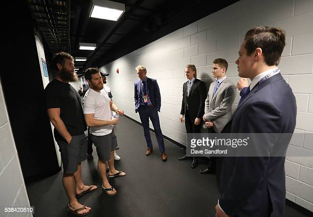 Joe Thornton Joe Pavelski and Joonas Donskoi of the San Jose Sharks greet draft prospects Patrik Laine Alexander Nylander Matthew Tkacuk PierreLuc...