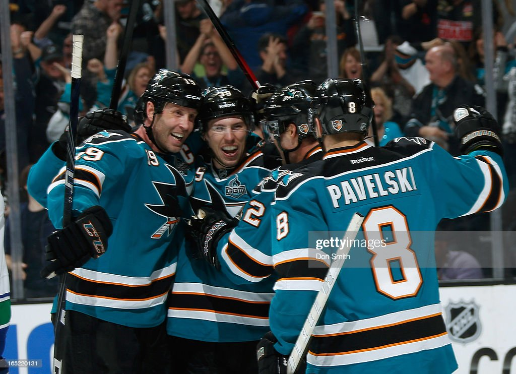 <a gi-track='captionPersonalityLinkClicked' href=/galleries/search?phrase=Joe+Thornton&family=editorial&specificpeople=201829 ng-click='$event.stopPropagation()'>Joe Thornton</a> #19, <a gi-track='captionPersonalityLinkClicked' href=/galleries/search?phrase=Joe+Pavelski&family=editorial&specificpeople=687042 ng-click='$event.stopPropagation()'>Joe Pavelski</a> #8 and <a gi-track='captionPersonalityLinkClicked' href=/galleries/search?phrase=Logan+Couture&family=editorial&specificpeople=809700 ng-click='$event.stopPropagation()'>Logan Couture</a> #39 of the San Jose Sharks celebrate a goal against the Vancouver Canucks during an NHL game on April 1, 2013 at HP Pavilion in San Jose, California.