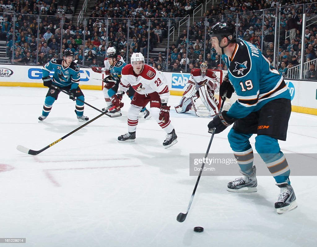 Joe Thornton #19, Joe Pavelski #8 and Logan Couture #39 of the San Jose Sharks hold the puck in the offensive zone against Oliver Ekman-Larsson #23 and Mike Smith #41 of the Phoenix Coyotes during an NHL game on February 9, 2013 at HP Pavilion in San Jose, California.