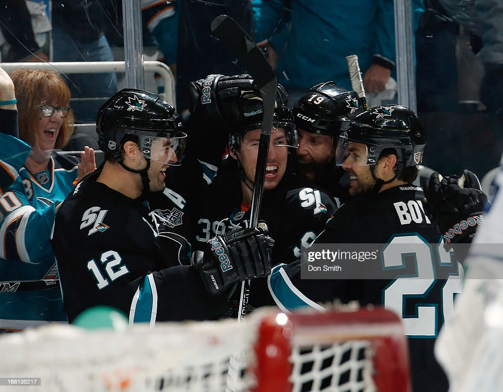 Joe Thornton #19, Logan Couture #39, Dan Boyle #22 and Patrick Marleau #12 of the San Jose Sharks celebrate Couture's goal against the Vancouver Canucks in Game One of the Western Conference Quarterfinals during the 2013 Stanley Cup Playoffs at HP Pavilion on May 5, 2013 in San Jose, California.