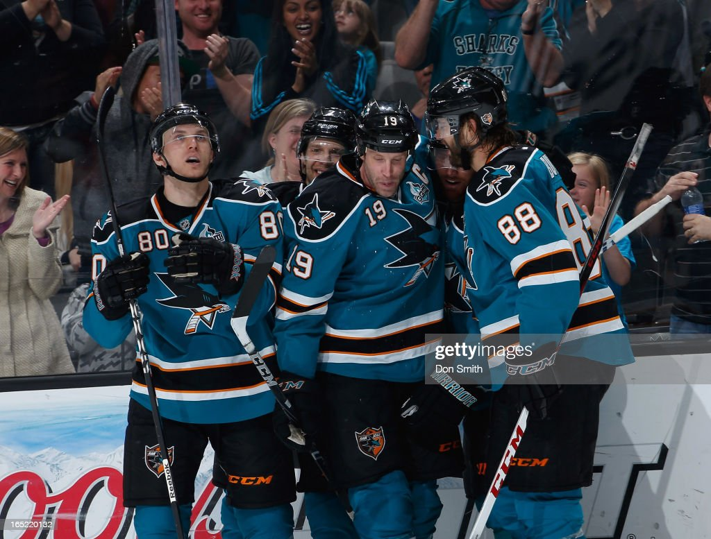 <a gi-track='captionPersonalityLinkClicked' href=/galleries/search?phrase=Joe+Thornton&family=editorial&specificpeople=201829 ng-click='$event.stopPropagation()'>Joe Thornton</a> #19, Matt Tennyson #80 and <a gi-track='captionPersonalityLinkClicked' href=/galleries/search?phrase=Brent+Burns&family=editorial&specificpeople=212883 ng-click='$event.stopPropagation()'>Brent Burns</a> #88 of the San Jose Sharks celebrate Thornton's goal and Tennyson's first NHL point against the Vancouver Canucks during an NHL game on April 1, 2013 at HP Pavilion in San Jose, California.