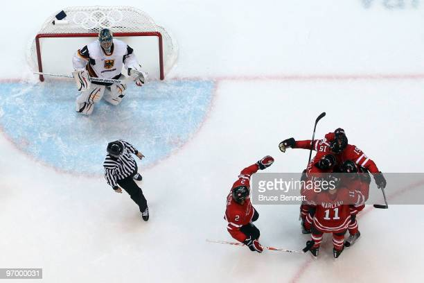 Joe Thornton of Canada celebrates with his team after scoring a goal past Thomas Greiss of Germany during the ice hockey Men's Qualification Playoff...