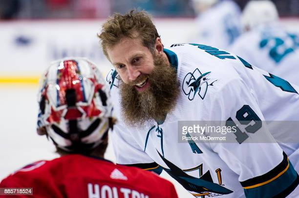 Joe Thornton of the San Jose Sharks and Braden Holtby of the Washington Capitals talk before a game at Capital One Arena on December 4 2017 in...