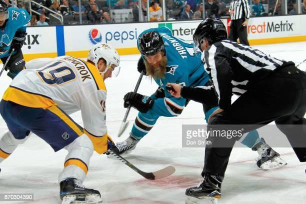 Joe Thornton of the San Jose Sharks and Calle Jarnkrok of the Nashville Predators faceoff at SAP Center on November 1 2017 in San Jose California