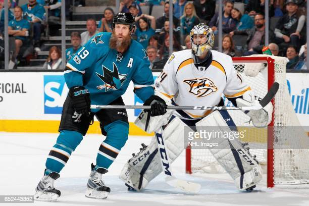 Joe Thornton of the San Jose Sharks and Juuse Saros of the Nashville Predators look during a NHL game at SAP Center at San Jose on March 11 2017 in...