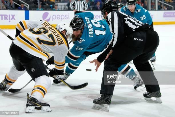Joe Thornton of the San Jose Sharks and Patrice Bergeron of the Boston Bruins faceoff at SAP Center on November 18 2017 in San Jose California