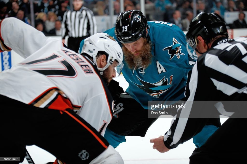 Joe Thornton #19 of the San Jose Sharks and Ryan Kesler #17 of the Anaheim Ducks face off during a NHL game at SAP Center at San Jose on March 18, 2017 in San Jose, California.