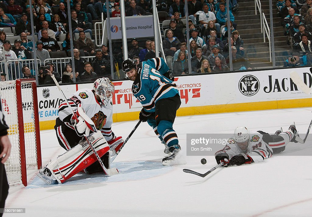 <a gi-track='captionPersonalityLinkClicked' href=/galleries/search?phrase=Joe+Thornton&family=editorial&specificpeople=201829 ng-click='$event.stopPropagation()'>Joe Thornton</a> #19 of the San Jose Sharks attacks the net against <a gi-track='captionPersonalityLinkClicked' href=/galleries/search?phrase=Corey+Crawford&family=editorial&specificpeople=818935 ng-click='$event.stopPropagation()'>Corey Crawford</a> #50 and <a gi-track='captionPersonalityLinkClicked' href=/galleries/search?phrase=Johnny+Oduya&family=editorial&specificpeople=3944055 ng-click='$event.stopPropagation()'>Johnny Oduya</a> #27 of the Chicago Blackhawks during an NHL game on February 5, 2013 at HP Pavilion in San Jose, California.