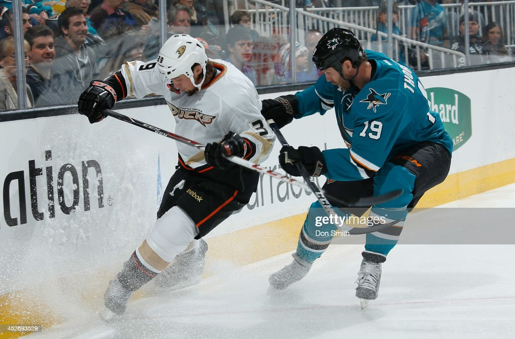 <a gi-track='captionPersonalityLinkClicked' href=/galleries/search?phrase=Joe+Thornton&family=editorial&specificpeople=201829 ng-click='$event.stopPropagation()'>Joe Thornton</a> #19 of the San Jose Sharks battles for the puck against <a gi-track='captionPersonalityLinkClicked' href=/galleries/search?phrase=Matt+Beleskey&family=editorial&specificpeople=570471 ng-click='$event.stopPropagation()'>Matt Beleskey</a> #39 of the Anaheim Ducks during an NHL game on November 30, 2013 at SAP Center in San Jose, California.