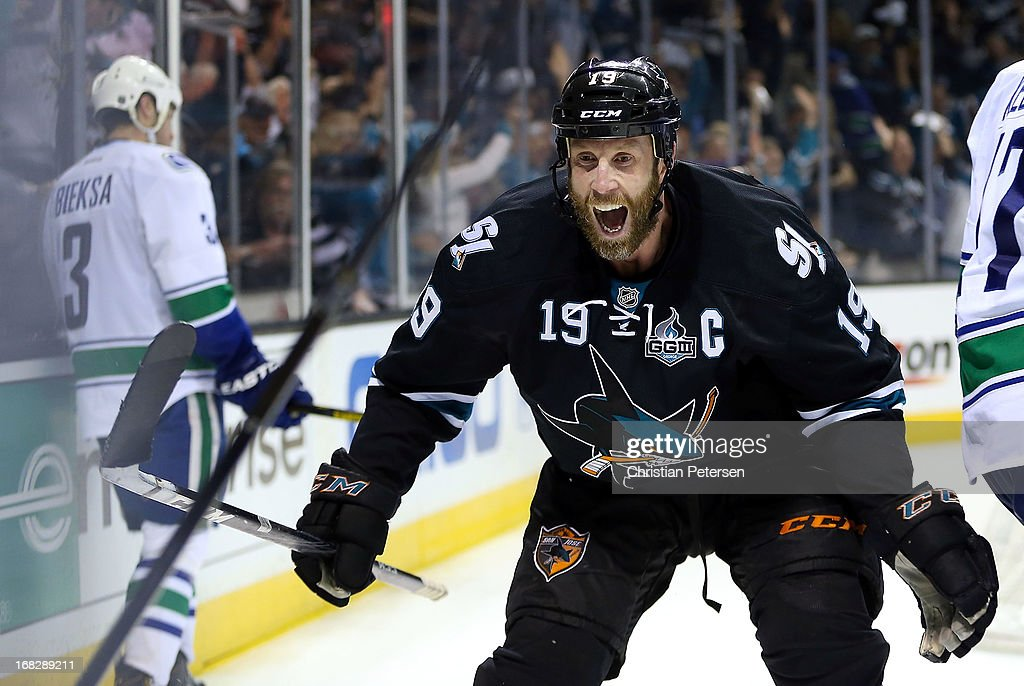 <a gi-track='captionPersonalityLinkClicked' href=/galleries/search?phrase=Joe+Thornton&family=editorial&specificpeople=201829 ng-click='$event.stopPropagation()'>Joe Thornton</a> #19 of the San Jose Sharks celebrates after Patrick Marleau (not pictured) scored the game winning goal against <a gi-track='captionPersonalityLinkClicked' href=/galleries/search?phrase=Kevin+Bieksa&family=editorial&specificpeople=688792 ng-click='$event.stopPropagation()'>Kevin Bieksa</a> #3 (L) and the Vancouver Canucks in overtime of Game Four of the Western Conference Quarterfinals during the 2013 NHL Stanley Cup Playoffs at HP Pavilion on May 7, 2013 in San Jose, California. The Sharks defeated the Canucks 4-3 to sweep the series 4 games to 0.