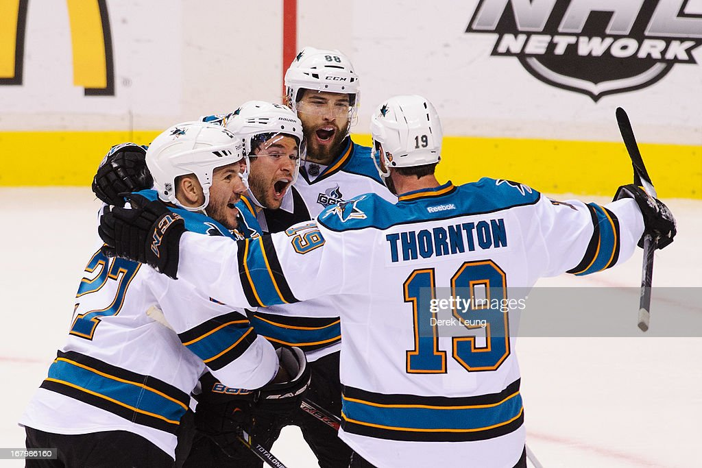 <a gi-track='captionPersonalityLinkClicked' href=/galleries/search?phrase=Joe+Thornton&family=editorial&specificpeople=201829 ng-click='$event.stopPropagation()'>Joe Thornton</a> #19 of the San Jose Sharks celebrates his first-period goal against the Vancouver Canucks with teammates <a gi-track='captionPersonalityLinkClicked' href=/galleries/search?phrase=Scott+Hannan&family=editorial&specificpeople=203195 ng-click='$event.stopPropagation()'>Scott Hannan</a> #27, <a gi-track='captionPersonalityLinkClicked' href=/galleries/search?phrase=T.J.+Galiardi&family=editorial&specificpeople=4324979 ng-click='$event.stopPropagation()'>T.J. Galiardi</a> #21, and <a gi-track='captionPersonalityLinkClicked' href=/galleries/search?phrase=Brent+Burns&family=editorial&specificpeople=212883 ng-click='$event.stopPropagation()'>Brent Burns</a> #88 in Game Two of the Western Conference Quarterfinals during the 2013 NHL Stanley Cup Playoffs at Rogers Arena on May 3, 2013 in Vancouver, British Columbia, Canada.