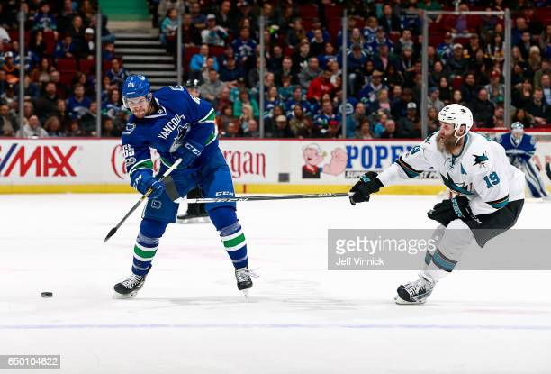 Joe Thornton of the San Jose Sharks checks Alexandre Grenier of the Vancouver Canucks during their NHL game at Rogers Arena February 25 2017 in...