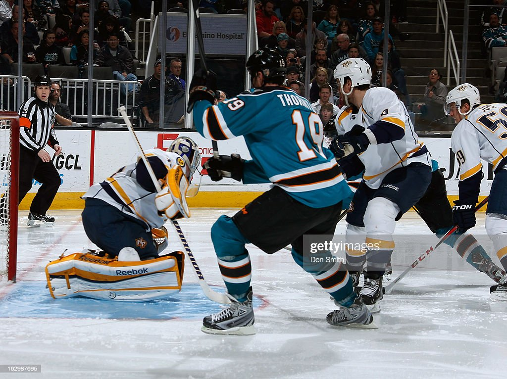 <a gi-track='captionPersonalityLinkClicked' href=/galleries/search?phrase=Joe+Thornton&family=editorial&specificpeople=201829 ng-click='$event.stopPropagation()'>Joe Thornton</a> #19 of the San Jose Sharks crashes the net against <a gi-track='captionPersonalityLinkClicked' href=/galleries/search?phrase=Pekka+Rinne&family=editorial&specificpeople=2118342 ng-click='$event.stopPropagation()'>Pekka Rinne</a> #35 and <a gi-track='captionPersonalityLinkClicked' href=/galleries/search?phrase=Shea+Weber&family=editorial&specificpeople=554412 ng-click='$event.stopPropagation()'>Shea Weber</a> #6 of the Nashville Predators during an NHL game on March 2, 2013 at HP Pavilion in San Jose, California.