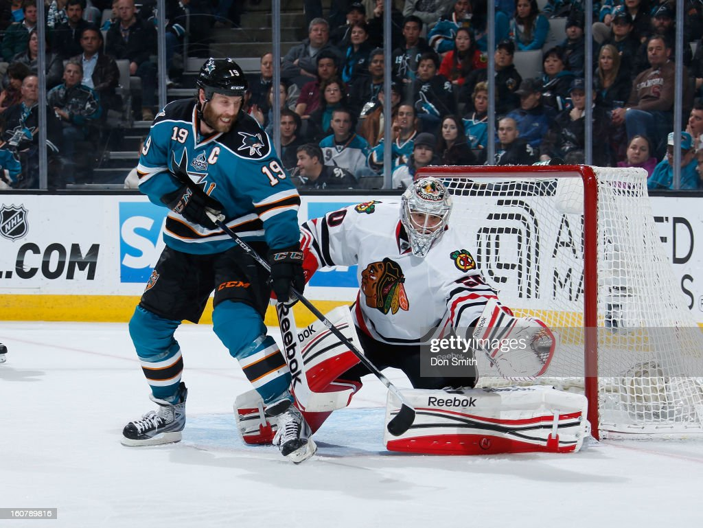 Joe Thornton #19 of the San Jose Sharks creates traffic in front of the net against Corey Crawford #50 of the Chicago Blackhawks during an NHL game on February 5, 2013 at HP Pavilion in San Jose, California.